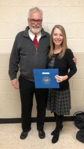 A photo of me with my dad as I'm holding my R.E.B. Award for Teaching Excellence certificate from my school district.