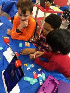 Students work together to create a block code.