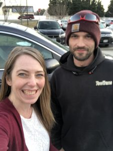 A photo of me and Tyler, the man who jump-started my car in the daycare parking lot.