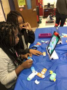 Students coding with block coding tiles from Osmo.